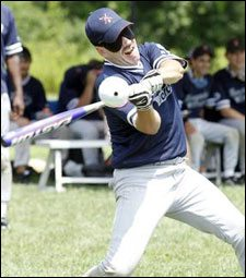 Image showing a member of the Boston Renegades swinging his bat.