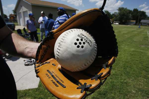Image of a beep baseball inside a baseball glove.