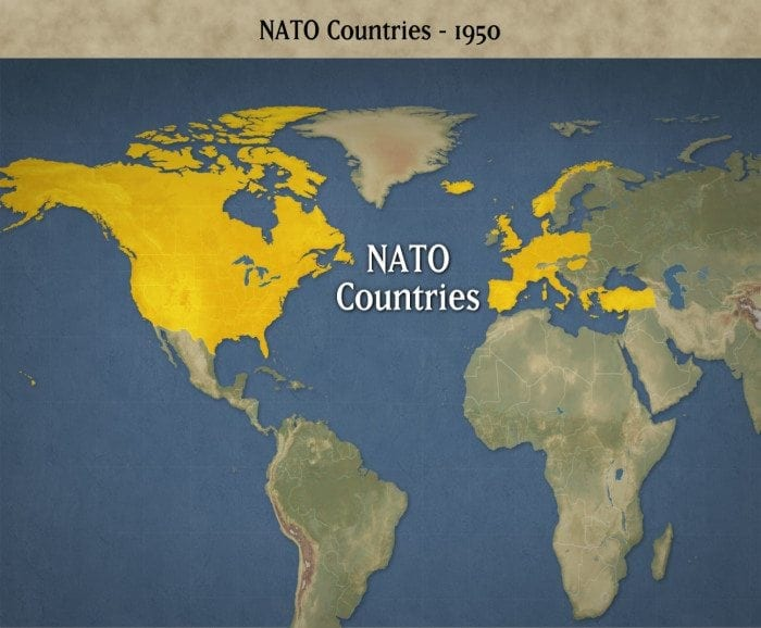 Image showing a map of the world with the 12 original NATO nations colored yellow.