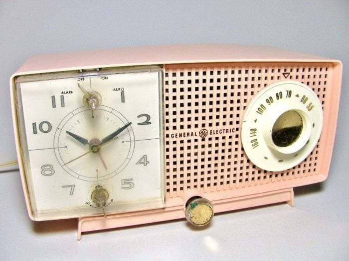 Image of a pink vintage 1950's style clock radio