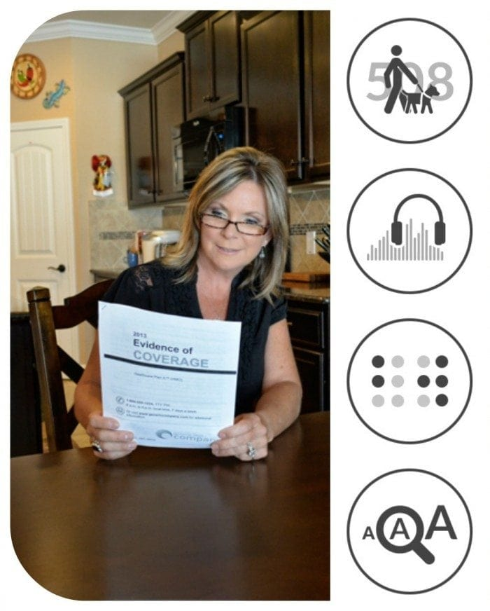 Image showing a woman sitting at her kitchen table reading a large print document.