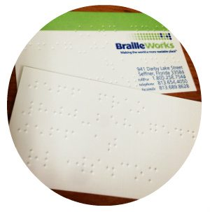 Circular image showing Sample Braille Business Cards by Braille Works