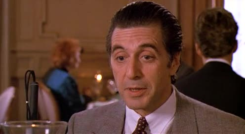Frank Slade (Al Pacino) sitting at a table in a fancy restaurant during a scene of Scent of a Woman
