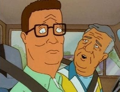 Hank Hill riding on the passenger-side of a car after being blinded during episode of King of the Hill