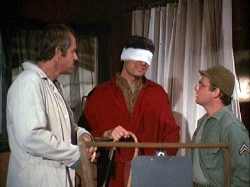 Hawkeye with bandages over his eyes during M*A*S*H Season 5 - Episode 99