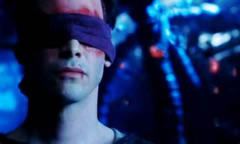 Neo wearing a blindfold to cover his wounded eyes after being blinded by Agent Smith near the end of Matrix Revolutions