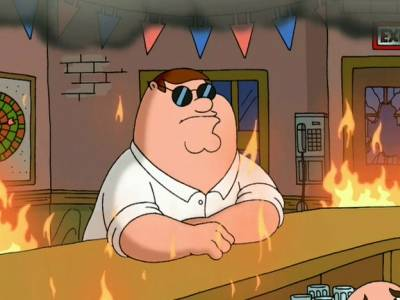 Peter Griffin sitting at the Drunken Clam bar while a fire rages around him.