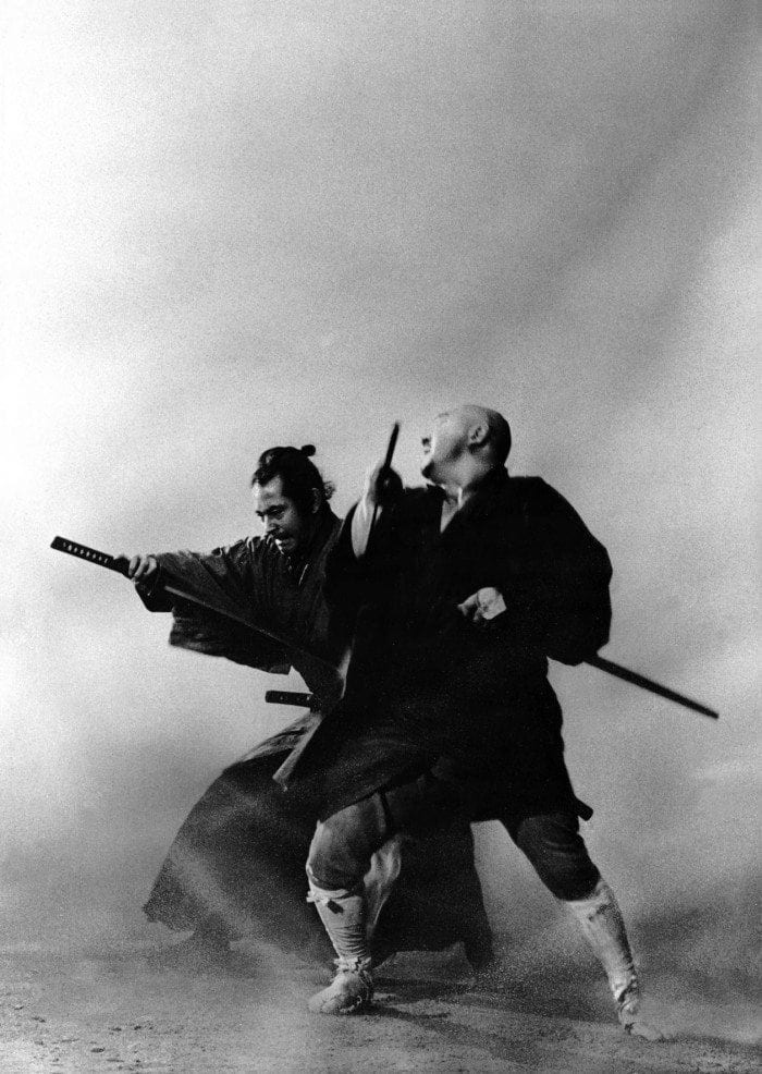 Black and white image showing Zatoichi in a swordfight with an adversary