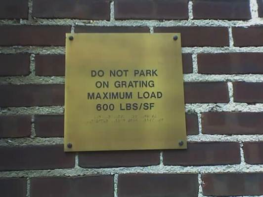"A ""Do Not Park"" sign in print and braille"