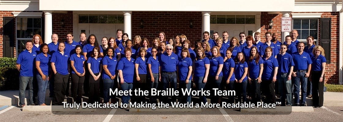 Image showing the Braille Works team standing together outside the office with the phrase - Meet the Braille Works Team - over-top.