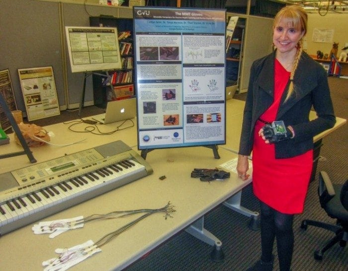 Image of Ph.D. student Caitlyn Seim with a few iterations of the wearable computing glove technology.