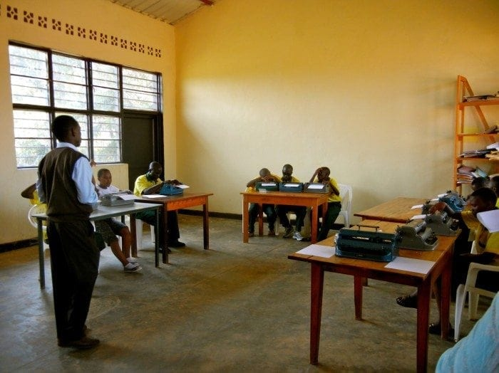 Image showing Eric Niyikiza teaching a class at the HVP Gatagara School for the Visually Impaired.
