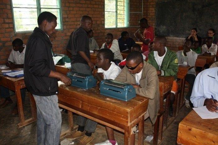 Image showing Eric Niyikiza teaching a braille class at Camp BE in Rwanda