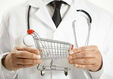 Image of a doctor holding a mini shopping cart in his hands.