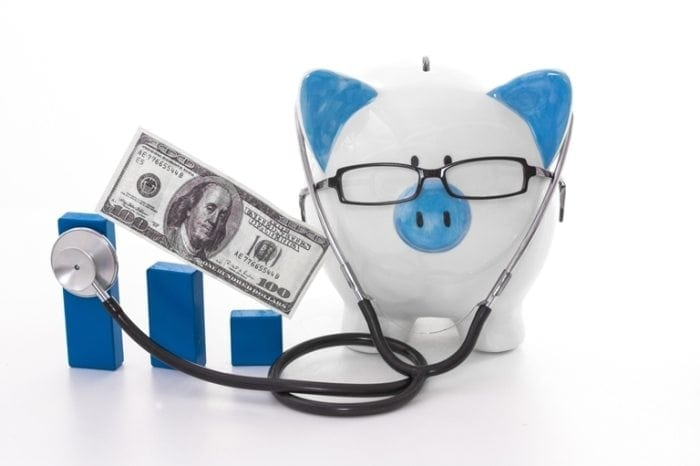 Image showing a blue and white piggy bank wearing glasses and a stethoscope.