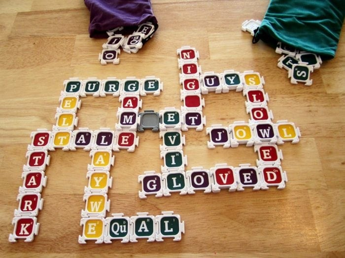 Image showing several Nab-It game pieces set up on a wooden floor