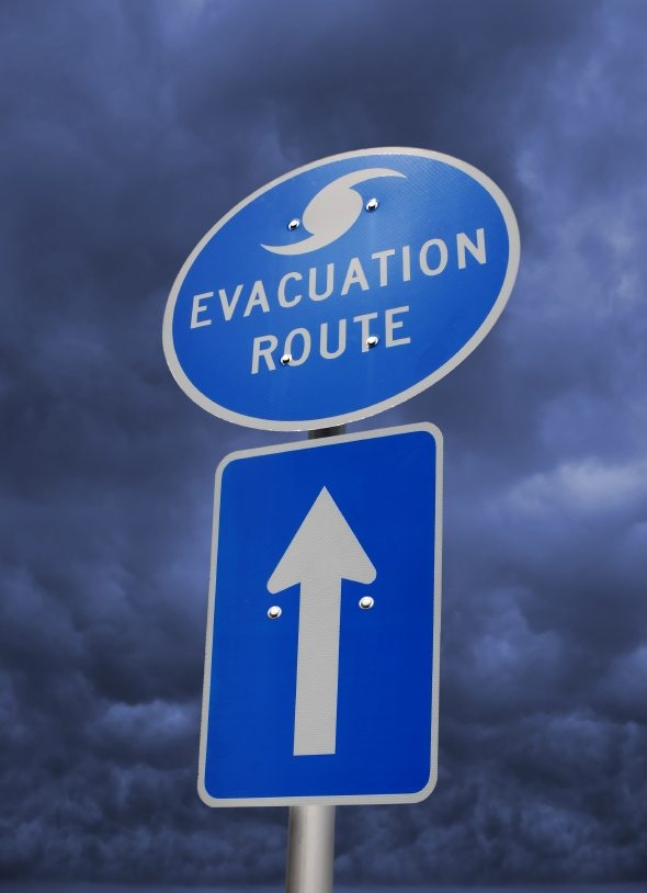 """Image showing a blue colored street sign with the words """"evacuation route"""" displayed and an arrow underneath."""