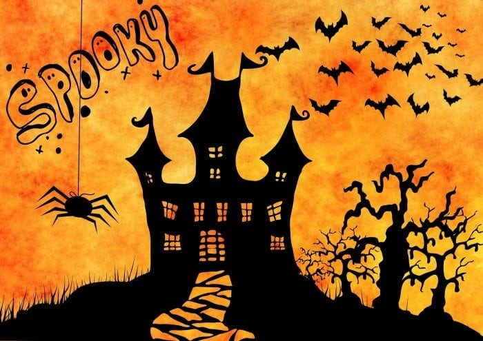 Scary Halloween castle with bats and spiders all around.