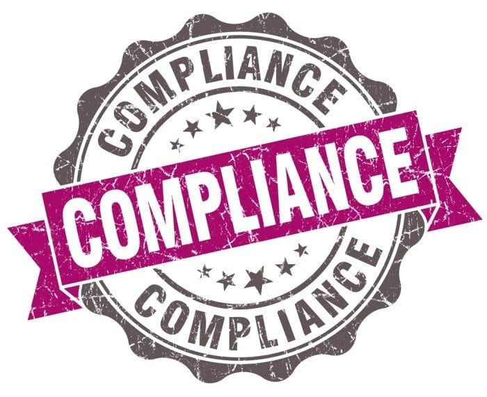 """Vintage seal with the word """"Compliance"""" displayed"""