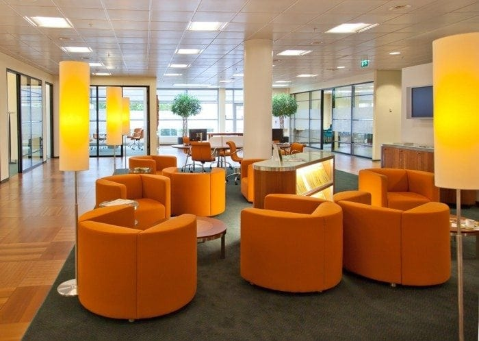 Bank lobby with modern style chairs, lamps and conference tables