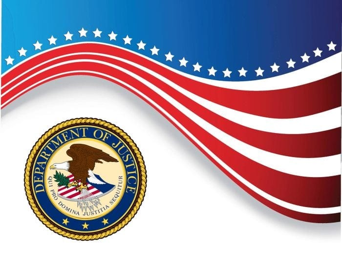 Official Department of Justice seal with an American flag graphic above