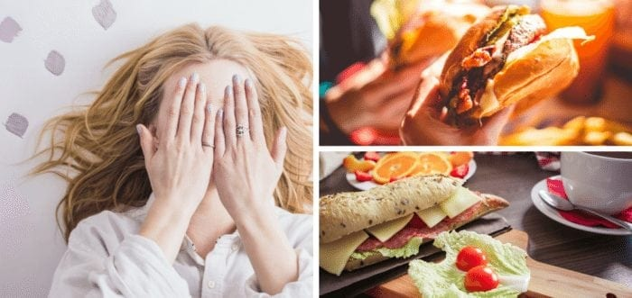 A woman covering her face with her hands, a delicious looking burger, and a cold-cuts sandwich with other appetizers on a table.