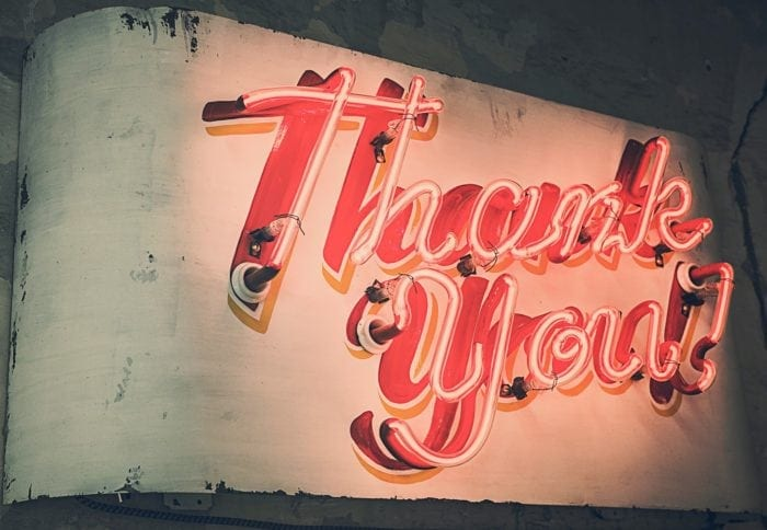 "Red neon sign displaying the words ""Thank You"""