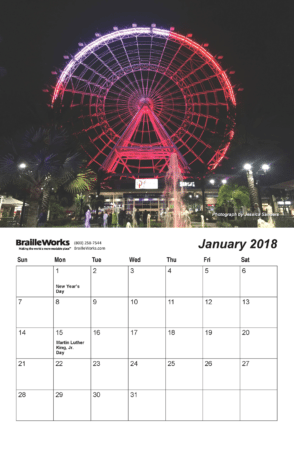 Inside page of the 2018 braille calendars showing the braille dot-layout and a ferris wheel in bright lights.