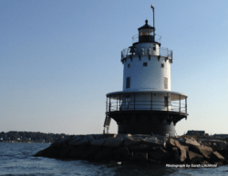 Image of lighthouse on the rocks.