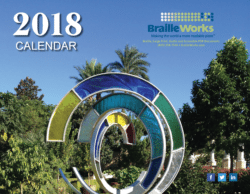 The front cover of 2018 calendar with coloful monument made of stained glass.