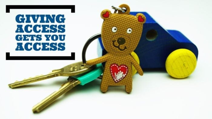 """Key chain with a small plastic bear attached. The phrase """"giving access gets you access"""" is displayed in text."""