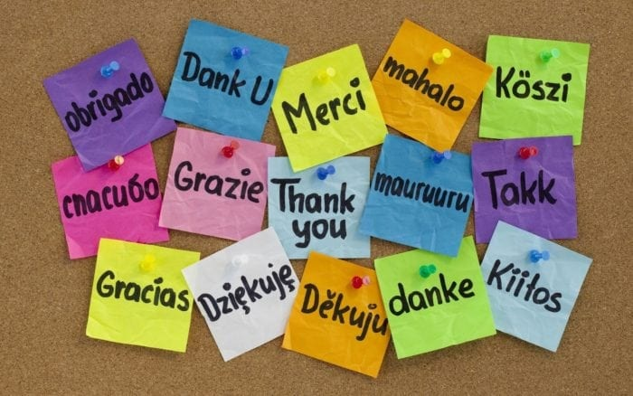 """Post-it notes with the words """"thank you"""" written on them in 15 different languages."""