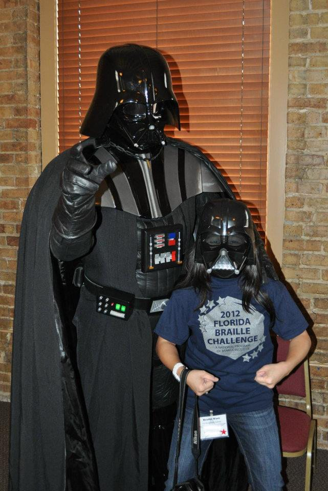 Braille Challenge participant posing for a picture with Darth Vader.