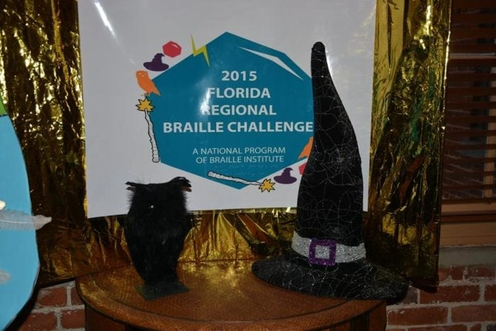 2015 Florida Braille Challenge sign with a black witches hat.