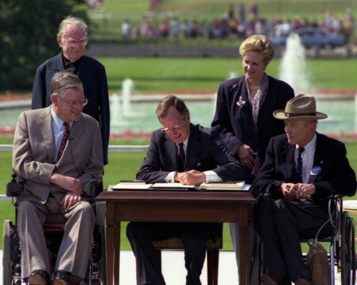 President Bush signs the Americans with Disabilities Act on the South Lawn of the White House.