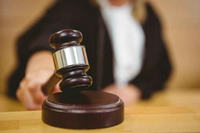 judge banging gavel in the court room enforcing accessibility laws