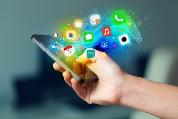 man holding smart phone with illustration of app icons and accessibility technology