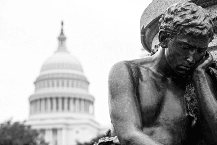 thinking man statue in front of the U.S. Capitol representing government agencies