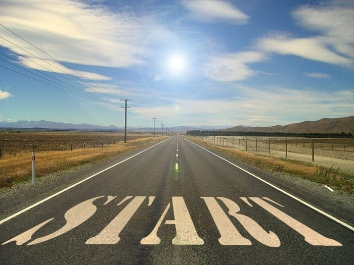 """An open road with the word """"start"""" on it."""