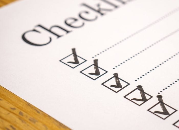 """a sheet ofpaper with the heading """"Checklist"""" and five checkboxes with check marks."""