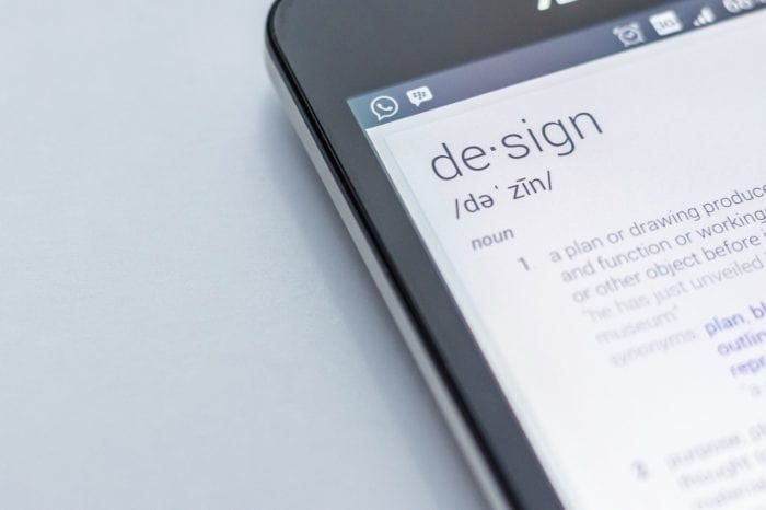 a cell phone with the word design and its definition