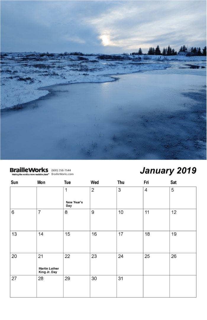 Inside page of the 2019 braille calendars showing the braille dot-layout, snow, and an icy river in Iceland.