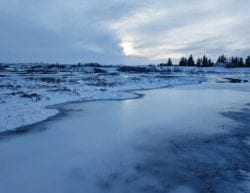 Snow and an icy river in Iceland.