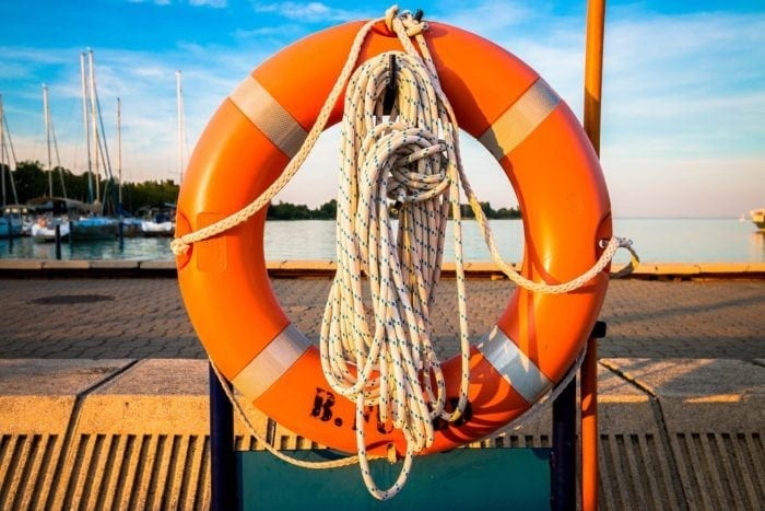 life preserver hanging on a dock over the water