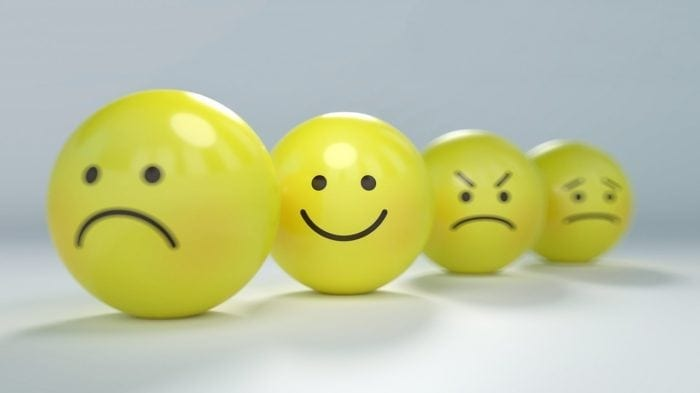 4 yellow balls with sad, happy, angry, and concerned faces