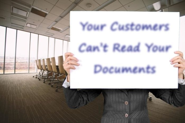 "Conference room with someone standing at the front with a large card in front of their face with blurry text that reads, ""Your Customers Can't Read Your Documents"""