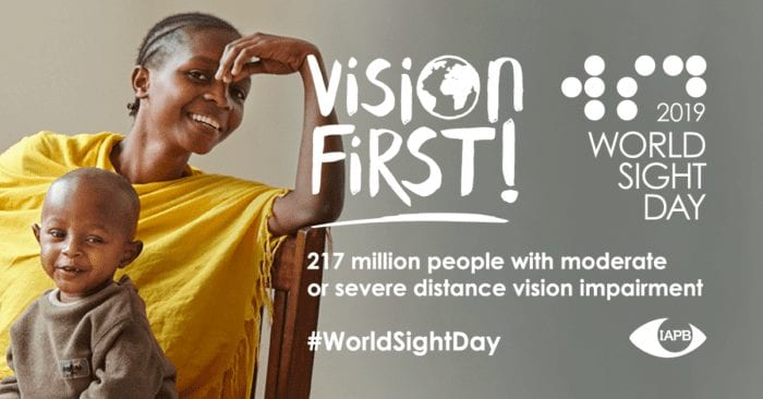 """Woman and child smiling with the words, """"Vision First! 2019 World Sight Day 217 million people with moderate or severe distance vision impairment #WorldSightDay"""" and the IAPB logo"""