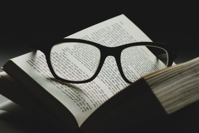 Eyeglasses placed in the middle of an open book