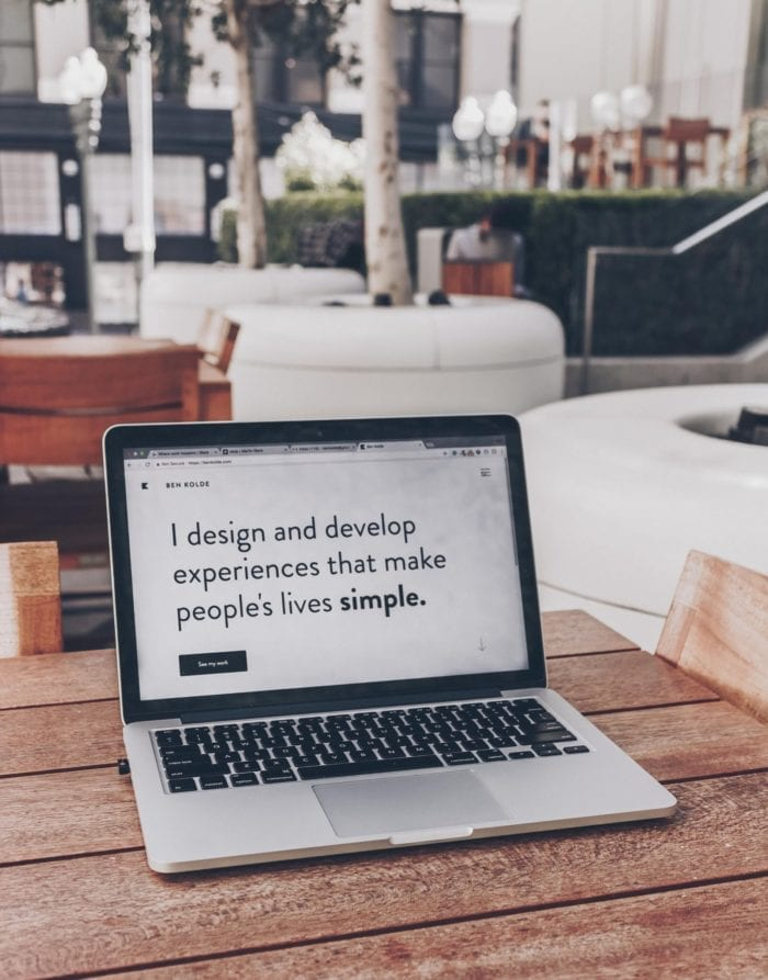 """a laptop screen that reads """"I design and develop experiences that make people's lives simple"""""""