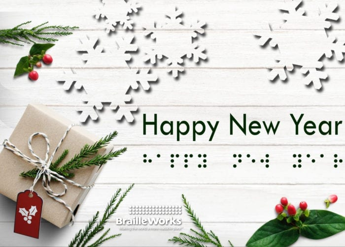 "The words, ""Happy New Year"" in print and braille dots surrounded by Christmas greenery and a present"
